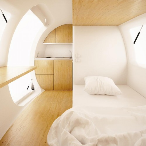 Ecocapsule couch and kitchen